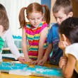 Cute preschoolers plaing game on table — Stock Photo #44603459