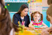 Little children at applique lesson — Stock Photo