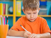 Cute little boy at lesson — Stock Photo