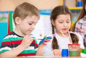 Cute children painting at kindergarten — Stock Photo