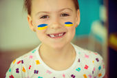 Ukrainian girl with national flag on cheek — Stock Photo