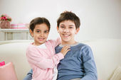 Happy brother and sister at home — Stock Photo