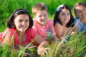Group of children resting in camp — Stock Photo