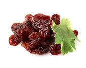 Raisins with leaf — Stock Photo