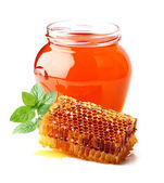 Fresh honey with honeycombs and mint — Stock Photo