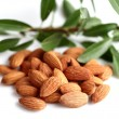 Stock Photo: Almonds kernel with leaves