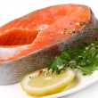 Salmon with lemon and arugula - Stock Photo