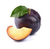 Ripe plum with slice — Stock Photo