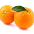 Ripe oranges with leaf — Stock Photo