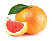 Grapefruit with slice — Stock Photo