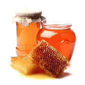Honey with honeycombs — Stock Photo