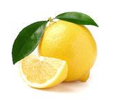 Juicy lemon with slice — Stock Photo