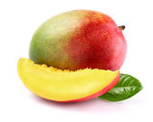 Ripe mango with slice — Stock Photo