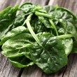 Spinach on a wooden background — Stock Photo