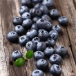 Blueberries on a wooden background — Stock Photo