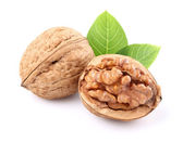 Dried walnuts with leaves — Stock Photo