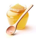 Fresh honey with wooden spoon — Stockfoto