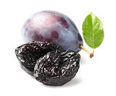 Prune and plum with leaf — Stock Photo