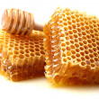 Honeycombs with spoon — Stock Photo #40487445