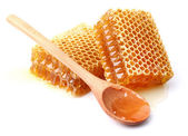 Honeycombs with spoon — Stock Photo
