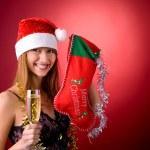 Beautiful girl with Christmas stocking — Stock Photo #1098815