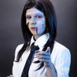 Funny zombie business woman pointing in camera  — Photo