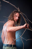 Long haired naked man with scary eyes — Stock Photo