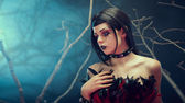 Attractive gothic girl in spiked choker — Stock Photo