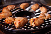 Grilled chicken on gas grill — Stock Photo