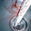 Bloody knife in kitchen sink — Stock Photo #31213337