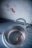 Bloody kitchen tile and washbasin — Stock Photo