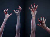 Set of bloody zombie hands — Stock Photo