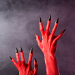 Red devil hands with black nails, real body-art — Stock Photo #43295465