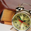 Golden alarm clock on the book — Stock Photo #12704900