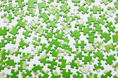Scattered green puzzle — Stock Photo