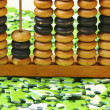 Wooden abacus on pile of green puzzle — Стоковая фотография