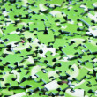 A pile of green puzzle - Stock Photo