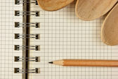 Notebook for culinary recipes and wooden spoon — Stock Photo