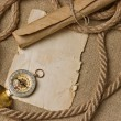 Stock Photo: Old paper with compass and rope