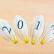School card with new year 2013 on the table — Stock Photo