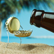 Funny bottle cork on a sandy beach — Stock Photo