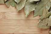 Dry bay leaf on a wooden kitchen cutting board — Stock Photo