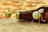 Funny bottle cork on a sandy beach — Stockfoto