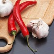 Garlic and red chili peppers - Stock Photo