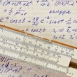Stock Photo: Page of old vintage paper with calculation of mathematic