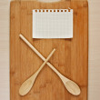 Stylized clock - cutting board and wooden spoons — Stockfoto