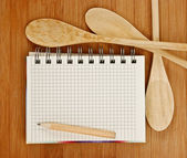 Notebook for culinary recipes on a kitchen cutting board — Stock Photo