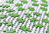 Green puzzles and symbols of money — Stock Photo