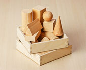 Wooden geometric shapes on the table — Stock Photo