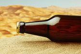 Bottle on sandy beach — Stock Photo